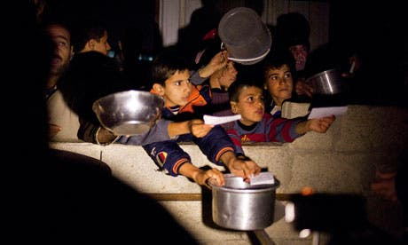 Syrian children beg for food at border crossing area in Syria. [guardian]