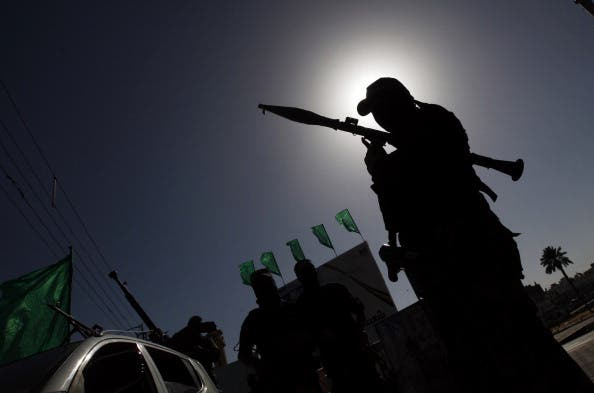 A Palestinian militant of the Ezzedine al-Qassam brigade. [MOHAMMED ABED/AFP/Getty Images]