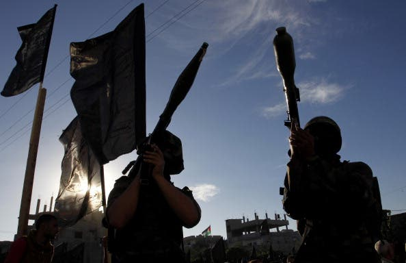 Palestinian militants of the Islamic Jihad hold rocket propelled grenades (RPG) as they take part in a rally against Israel in the southern Gaza Strip town of Rafah, on October 24, 2013. [Photo credit: SAID KHATIB/AFP/Getty Images]