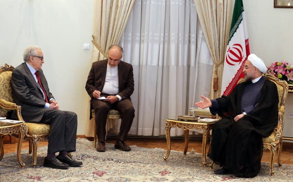 Iranian President Hassan Rouhani  meets with International Peace envoy to Syria Lakhdar Brahimi  in Tehran on October 27, 2013.  [ATTA KENARE/AFP/Getty Images]