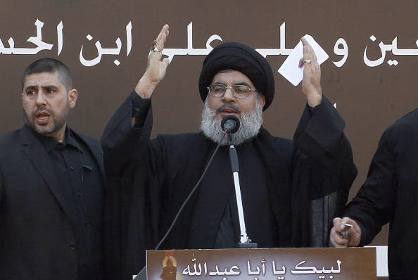 The head of Lebanon's militant Shiite Muslim movement Hezbollah, Hassan Nasrallah gives a speech during a massive Shiite Muslim commemoration in southern Beirut on November 14, 2013. [Getty Images]