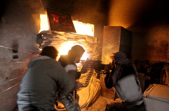 Rebel fighters from the Free Syrian Army fire a heavy machine gun during fighting against government forces on November 18, 2013 in the Salah al-Din neighbourhood of the northern Syrian city of Aleppo. (Getty Images)