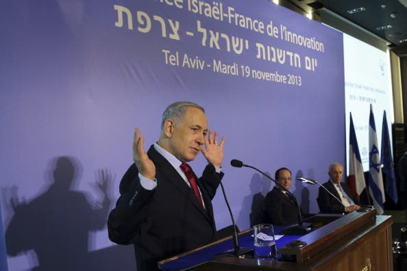 Israeli Prime Minister Benjamin Netanyahu delivers a speech attended by French President Francois Hollande and Israel's President Shimon Peres in Tel Aviv on November 19, 2013. [Getty Images]