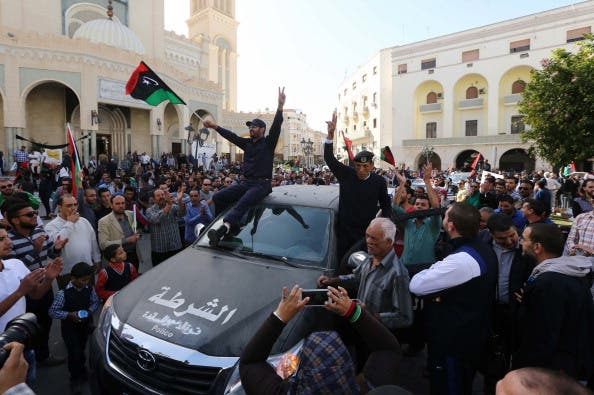 attend a demonstration alongside Libyan civilians in Tripoli against the presence of militia in the capital and in support of the army and police on November 19, 2013. [MAHMUD TURKIA/Getty Images]