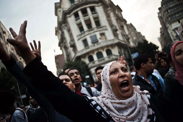 Egyptian Activists and members of the 6th of April movement shout slogans against the Egyptian Military on November 27, 2013, in Cairo. [Gianluigi Guercia/AFP]