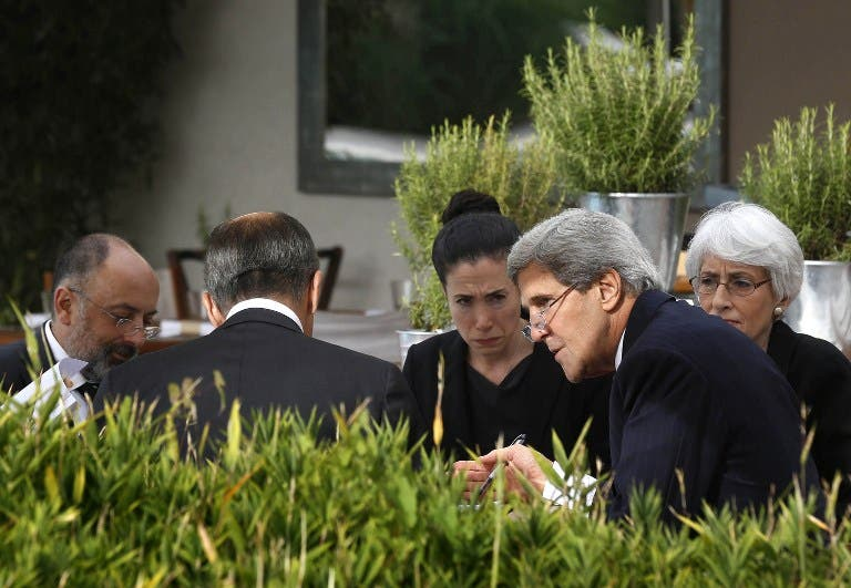 US Secretary of State John Kerry and Russian Foreign Minister Sergei Lavrov (back to camera) meet while seated with their senior aides at a hotel in Geneva on September 14, 2013.  [AFP]