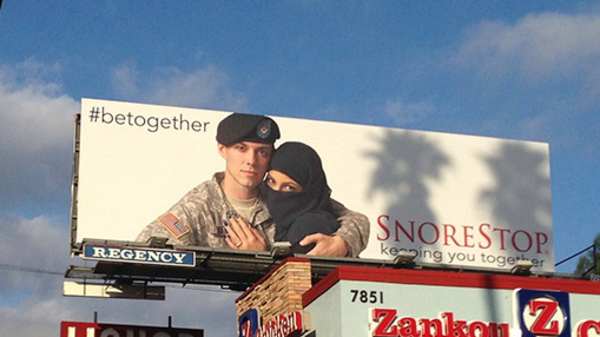 Billboard featuring U.S soldier and a Muslim woman displayed along Sunset Boulevard in Los Angeles. [Alarabyah.net]