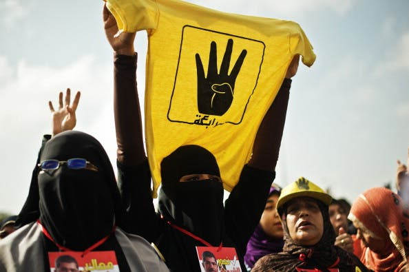 A female supporter of the Muslim Brotherhood and of ousted president Mohamed Morsi during a rally outside the Police Academy where his trial is taking place on November 4, 2013, in Cairo. [GIANLUIGI GUERCIA/AFP/Getty Images]