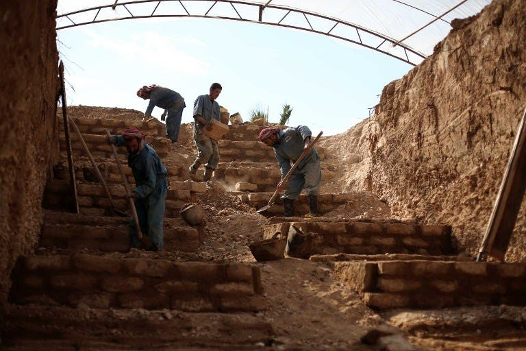 This file photo taken on November 9, 2015 shows workers constructing a layered cemetery in the rebel-held town of Douma, east of the Syrian capital Damascus to make space for the burial of the increasing number of casualties due to airstrikes by the Syrian regime. (AFP/Amer Almohibany)