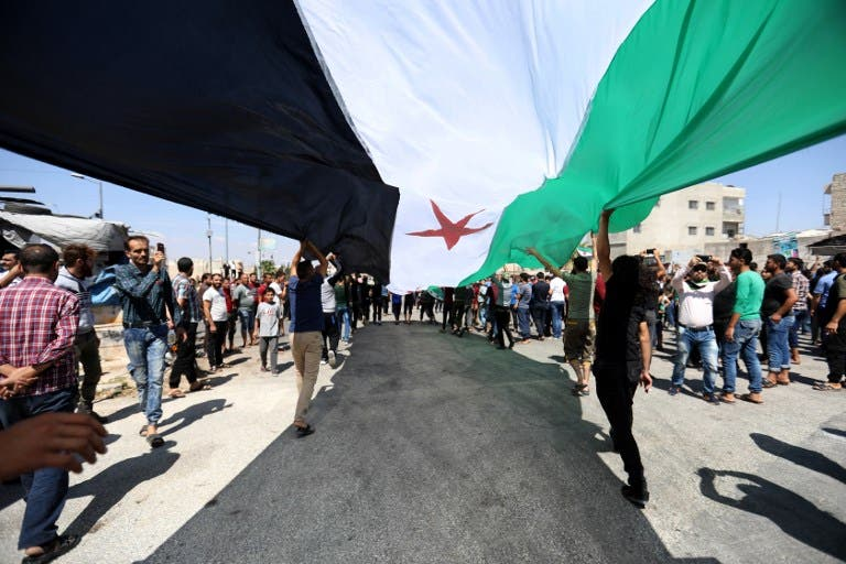 Damascus has every right to take back all its territory, Russian President Vladimir Putin told a summit on September 7 expected to decide the fate of Syria's last major rebel bastion Idlib. (OMAR HAJ KADOUR / AFP)