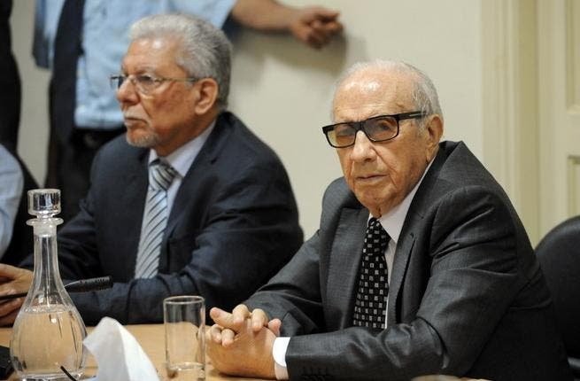 Tunisian mediator and Secretary General of the Tunisian General Labour Union (UGTT) Houcine Abbassi speaks during a meeting as part of the dialogue between ruling Islamists and the opposition. [AFP]
