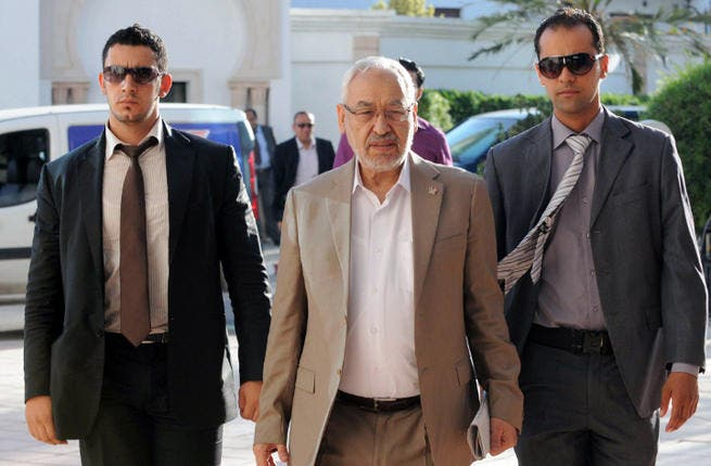 Tunisia's ruling Islamist Ennahda party's leader Rached Ghannouchi (C) arrives for a meeting as part of talks with the opposition. (Image credit: AFP)