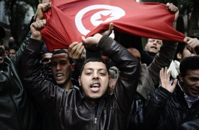 People holding a Tunisian flag during a protest in Tunis.