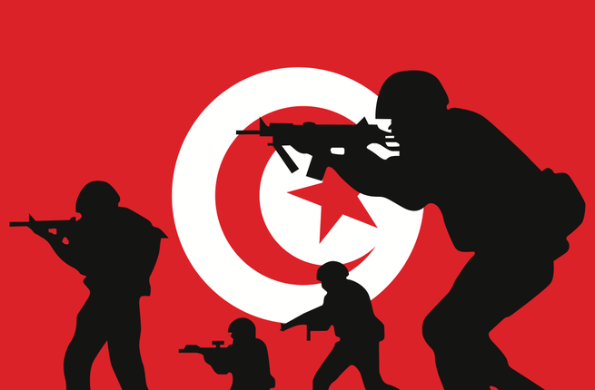 The Tunisian flag and the silhouette of soldiers (Shutterstock/Paul Stringer)