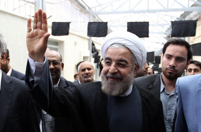 Hassan Rowhani, a moderate Iranian presidential candidate and former top nuclear negotiator, waves as he arrives for to campaign at the Jamaran mosque in Tehran (Atta Kanare/ AFP)