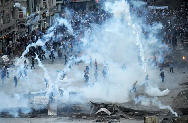 Protestors clash with Turkish riot policemen on Taksim square on June 11 (Bulent Kilic / AFP)