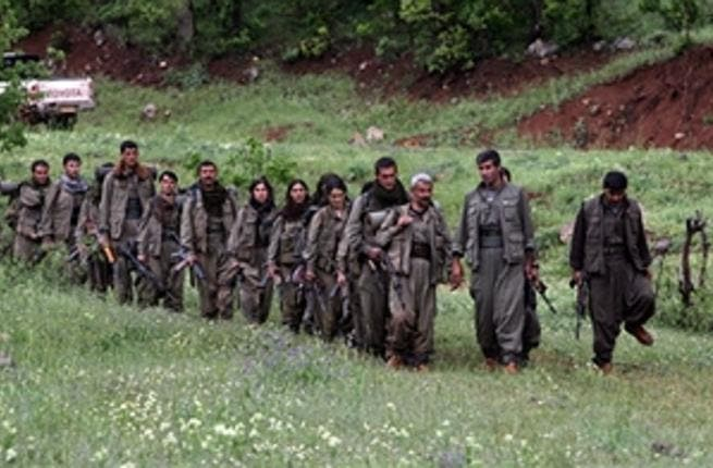 Kurdistan Workers' Party (PKK) fighters arrive in the northern Iraqi city of Dohuk on May 14, 2013, after leaving Turkey as part of a peace drive with Ankara. (AFIN HAMED/AFP/Getty Images)