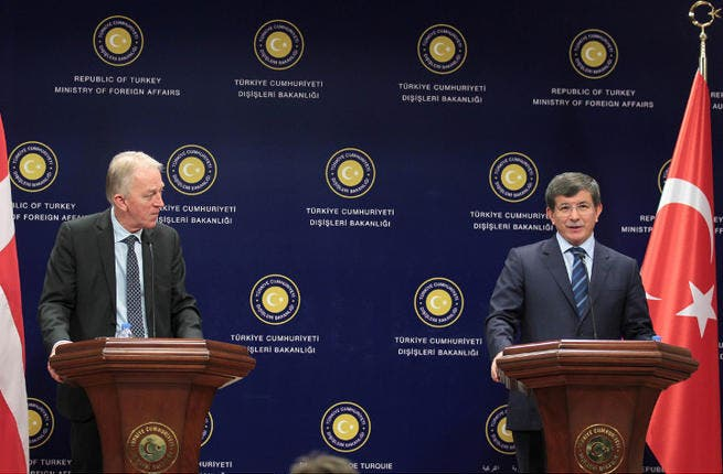 Turkish Foreign Minister Ahmet Davutoglu (R) gives a press conference with his Danish counterpart.  Davutoglu denies Turkey shared intelligence with Israel to expose an Israeli spy ring. (Image credit: AFP)