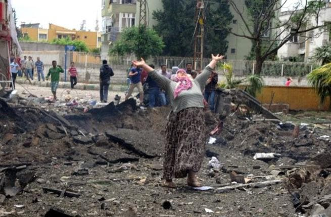 Turkish women in distress at the site of bomb explosion on the Syria border