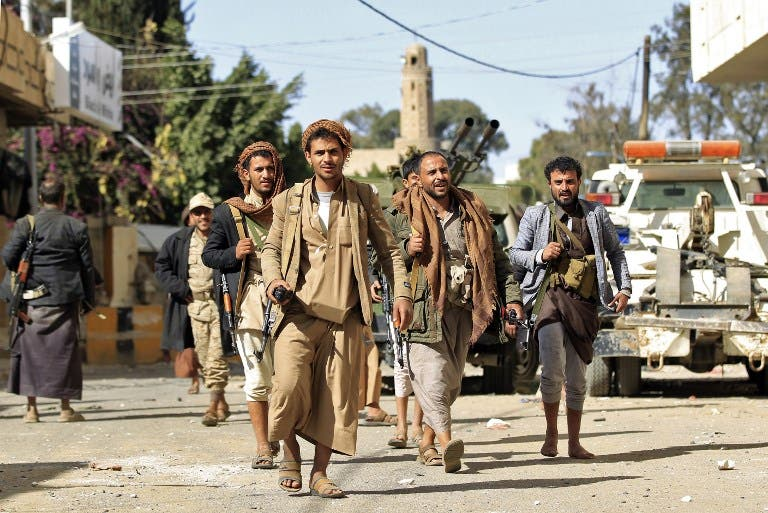 Houthi rebel fighters are seen outside of the residence of Yemen's former President Ali Abdullah Saleh in Sanaa on December 4, 2017. (Mohammed Huwais/AFP)