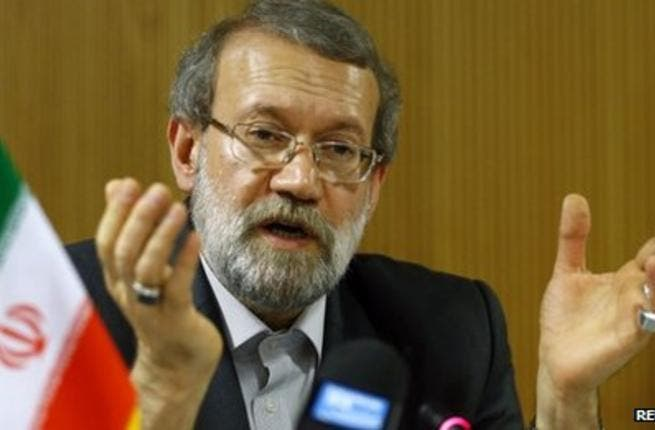 Iran's Parliament Speaker Ali Larijani told reporters Wednesday that Iran had more uranium than it needed, but other Iranian MPs have denied his claim (Reuters)