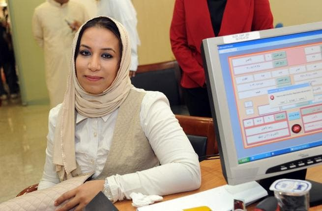 Kuwaiti candidate Haya al-Mutairi registers in the last day for the upcoming parliamentary election in Kuwait City on July 6 (AFP)