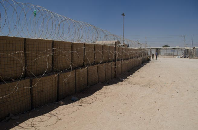 Barbed wire encloses the refugee camp, with some displaced Syrians referring to Zaatari as a prison. (AlBawaba/J. Zach Hollo)