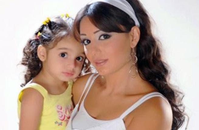 Dima Al Jundi with her daughter