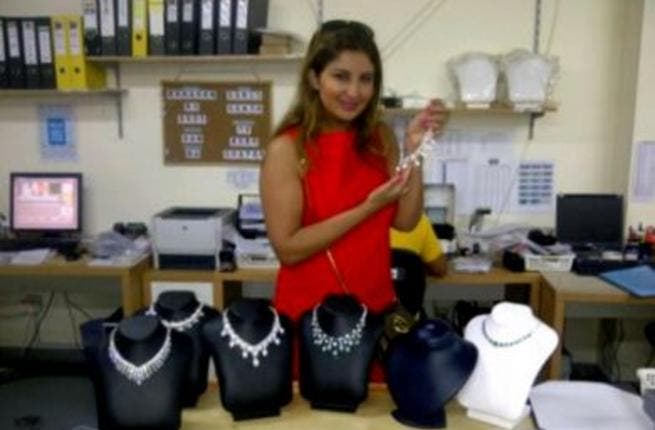 Shatha displaying necklaces