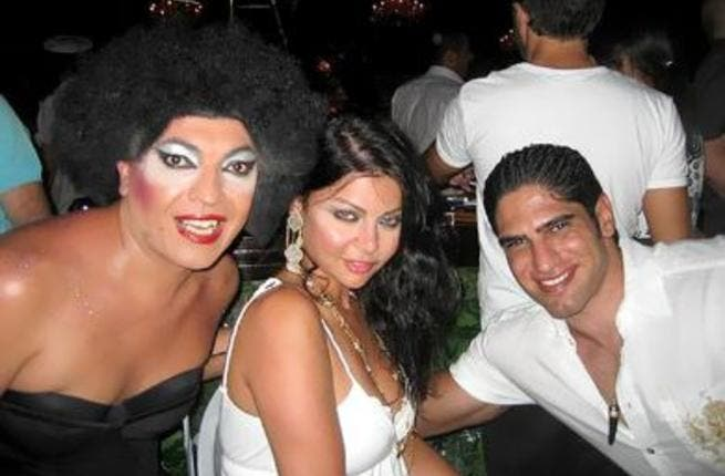 Haifa and her husband with a Turkish Drag Queen