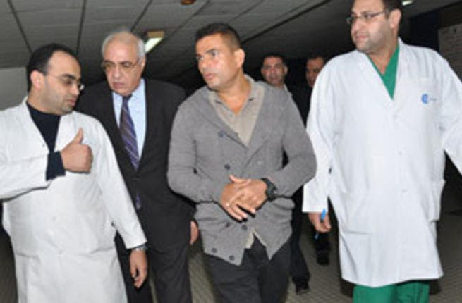 Amro Diab visiting patients at hospital