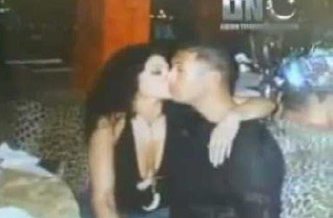 Photo of woman kissing Mu'tasim Al Gaddafi