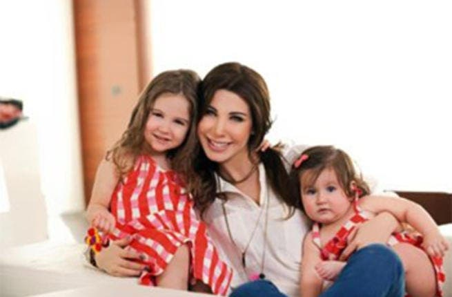 Nancy Ajram and her daughters