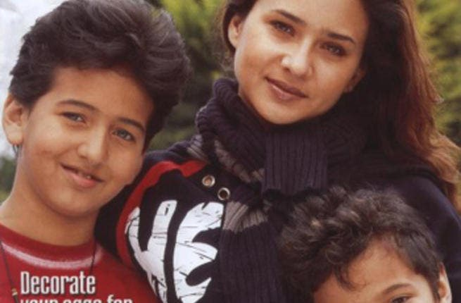 Nelly Kareem and her two sons