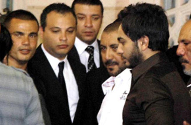 Tamer and Amro during funeral