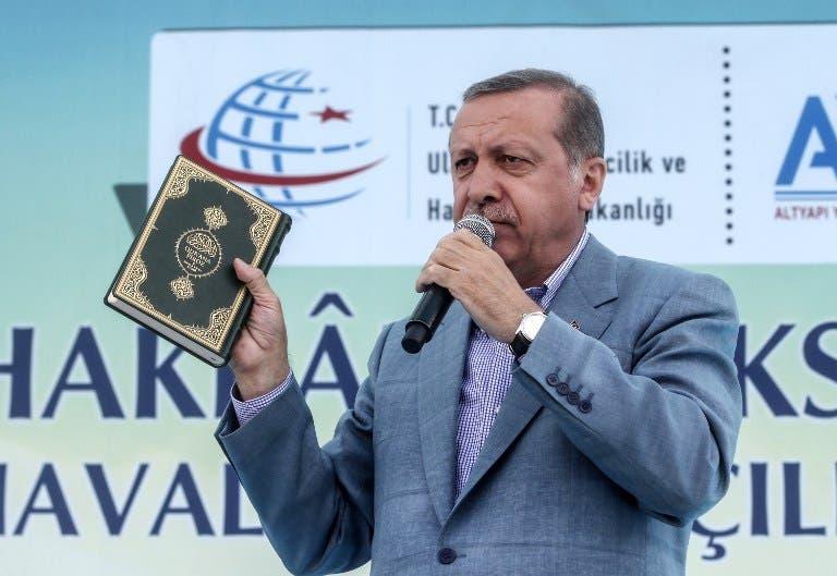 http://www.albawaba.com/sites/default/files/im/erdogan-holding-koran-afp.jpg