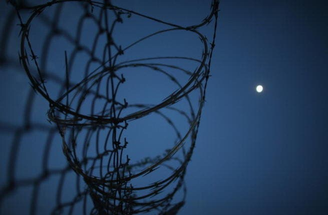 Razor wire is seen on the fence around the currently closed Camp X-Ray which was the first detention facility to hold 'enemy combatants' at the U.S. Naval Station on June 27, 2013 in Guantanamo Bay, CubaBarbed wire (Getty Images/Joe Raedle)