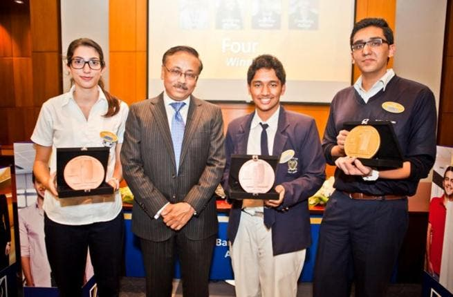Winners of Emirates NBD Banker for a Day online competition with senior officials from the bank