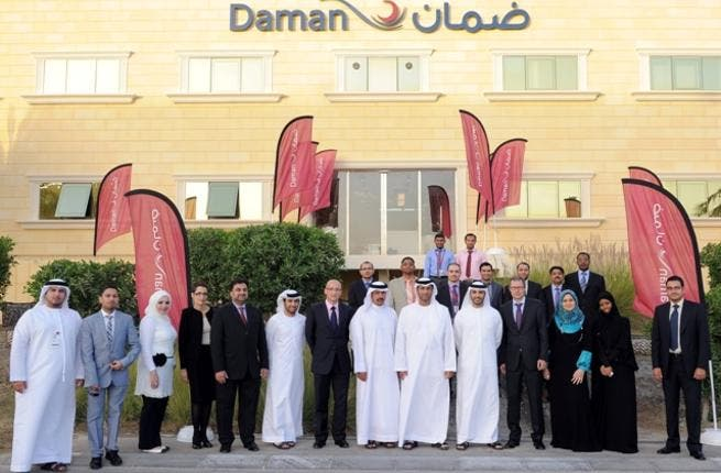 Daman's Chairman with the management and employees of the new branch
