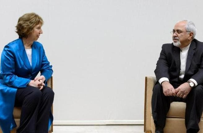 European Union foreign policy chief Catherine Ashton (L) talks to Iranian Foreign Minister Mohammad Javad Zarif before the start of two days of closed-door nuclear talks at the United Nations offices in Geneva. [arneruhnau]