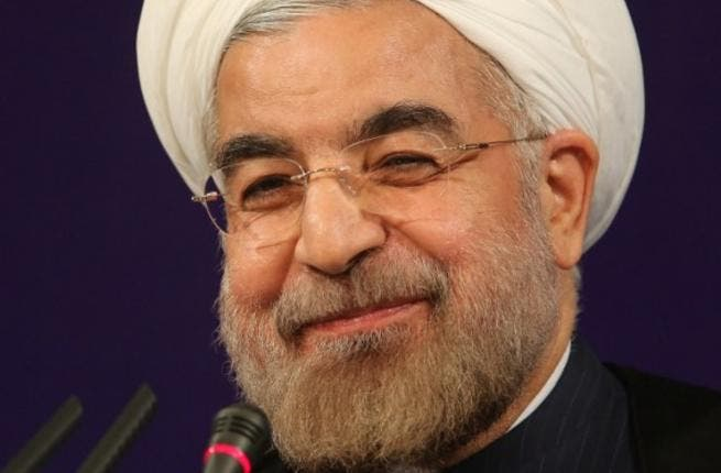 RAN, Tehran : Iran's President Hasan Rowhani smiles as he adresses his first news conference since taking office, in Tehran, on August 6, 2013. Rowhani said that Iran was ready for