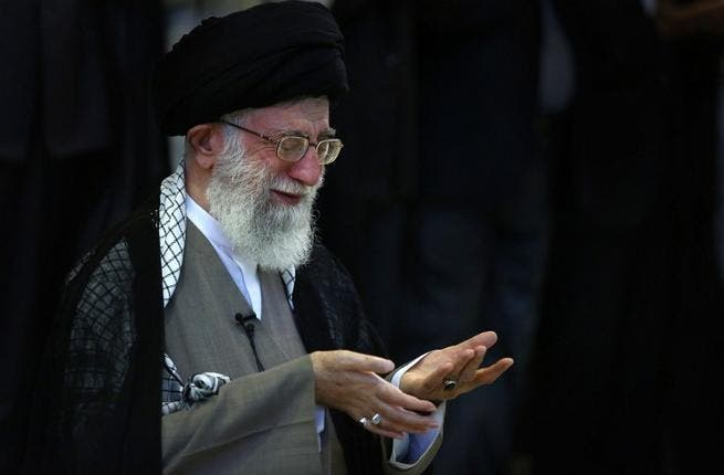 RAN, Tehran : A handout picture released by the official website of Iran's supreme leader, Ayatollah Ali Khamenei, shows him leading Eid al-Fitr prayers at Tehran University in the Iranian capital on August 9, 2013.