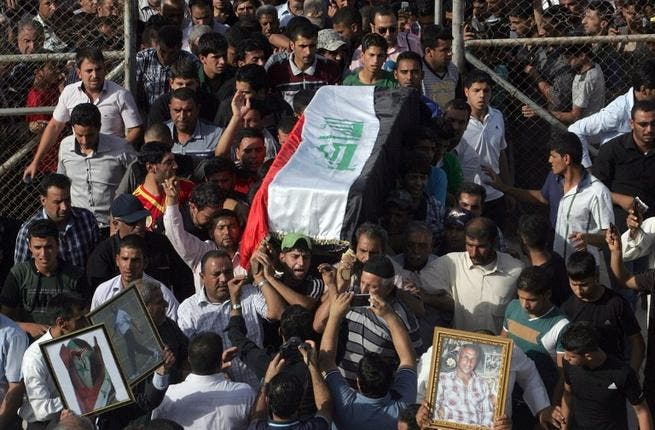 Family and friends carry the coffin of Iraqi Karbala Club football coach Mohammad Abbas, during his funeral in the central Iraqi city of Karbala. Abbas and some team members were allegedly beaten by security forces (AFP)