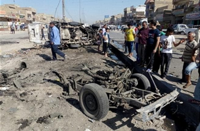 Iraqis inspect the site of a car bomb explosion in the impoverished district of Sadr City in Baghdad on July 29, 2013. (AHMAD AL-RUBAYE/AFP/Getty Images)