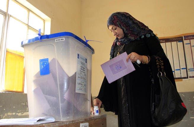 An Iraqi woman casts her vote at a polling station during provincial elections on June 20, 2013 in the Anbar province. Iraqis in two Sunni-majority provinces voted under heavy security in delayed provincial polls as the country grapples with a surge in nationwide violence and months of angry protests. (AFP/AZHAR SHALLAL)
