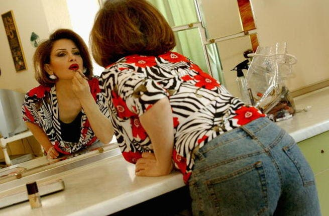 A woman applies make up (image used for illustrative purposes)