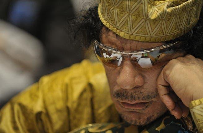 Moammar Gadhafi, then Libya's chief of state, attending the 12th African Union Summit in Addis Ababa, Ethiopia, Feb. 2, 2009. Qaddafi was elected chairman of the organization. (Source: Wikimedia/Jesse B. Awalt)