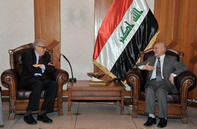 A handout picture released by the Iraqi government shows UN-Arab League envoy Lakhdar Brahimi (L) meeting with Iraq's deputy prime minister in charge of energy Hussain Ibrahim Saleh. (Image credit: AFP PHOTO/HO/IRAQI GOVERNMENT)
