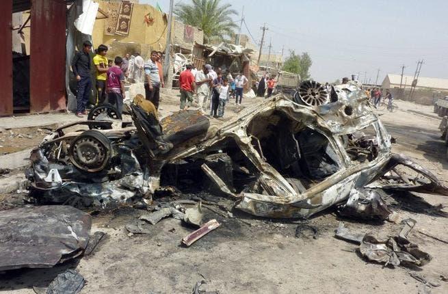 Aftermath of a car bombing in al-Obaidi neighborhood, east of Baghdad (AFP/ Ali Al-Saadi)