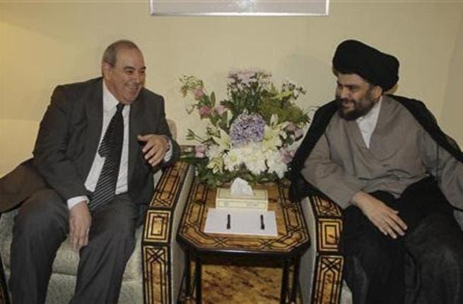 (R) Moqtada Al-Sadr with Ayad Allawi